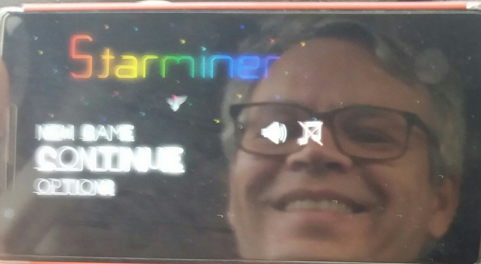 Edi Woodcock reflected on his phone's screen while running Starminer